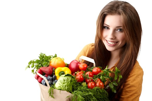 woman-holding-a-bag-full-of-healthy-food.-shopping