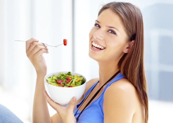 happy_woman_eating_salad